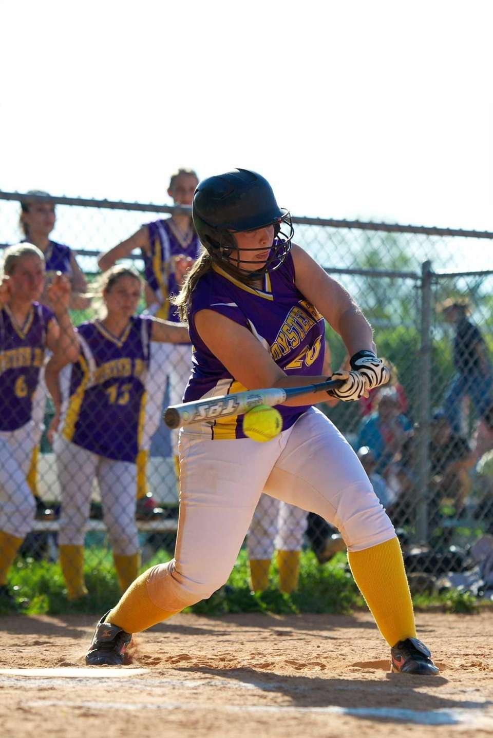 Oyster Bay left fielder Kristen Poppe swings at