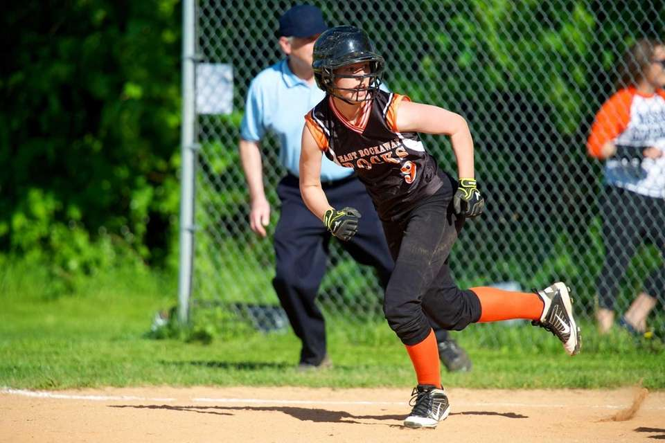 East Rockaway catcher Jess Deptulski runs to second
