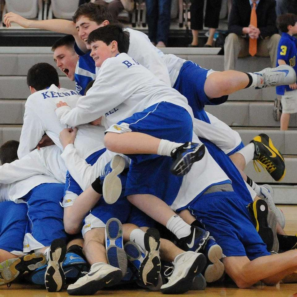 Kellenberg High School players celebrate after defeating Chaminade