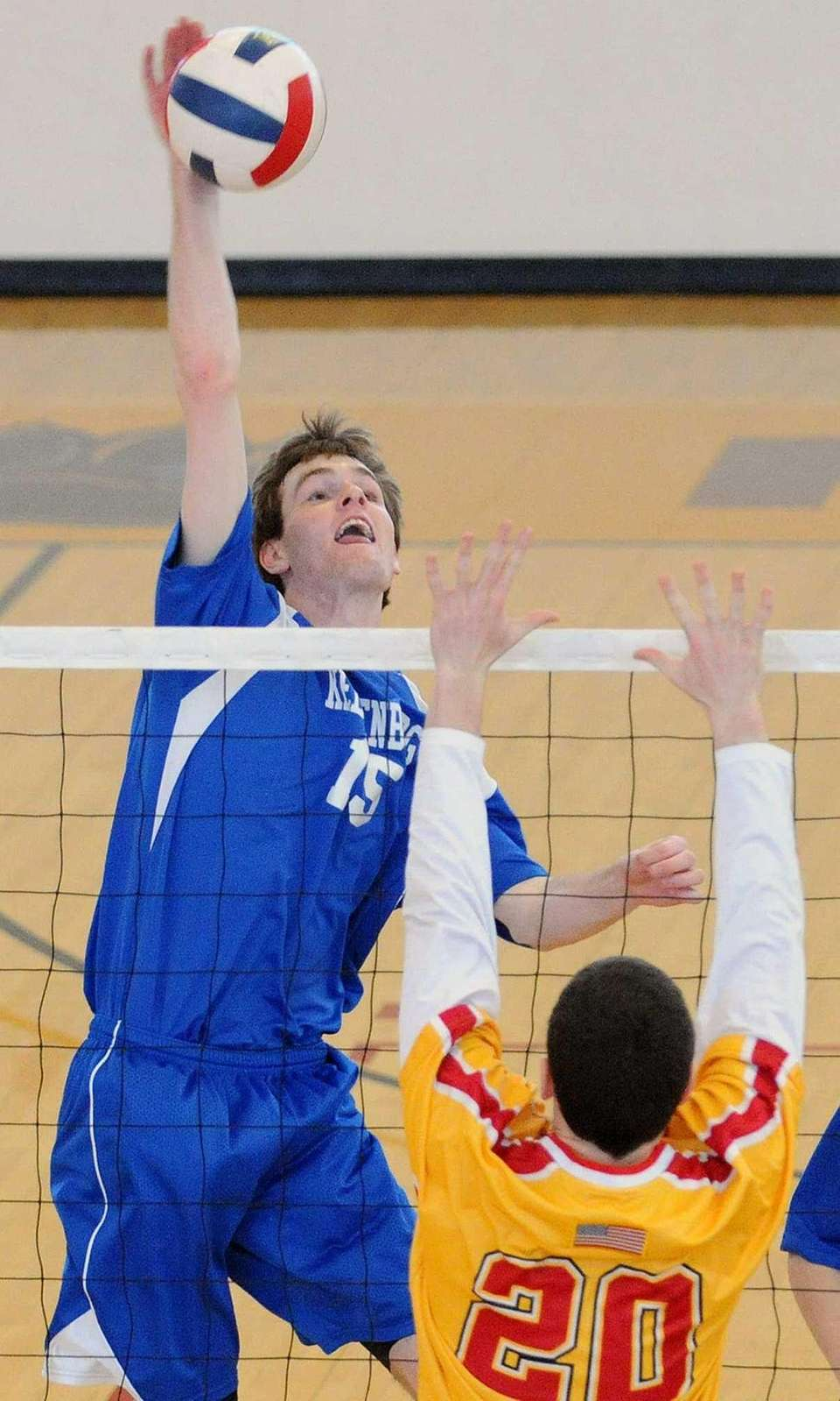 Kellenberg's Robert Kovalsky tries to spike over Chaminade's