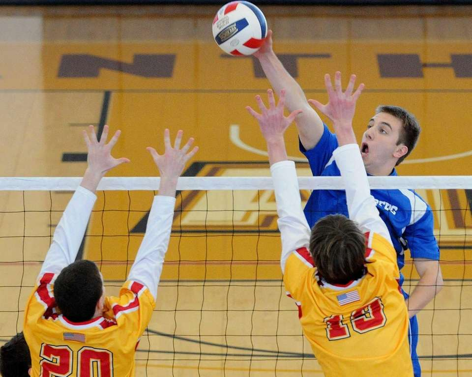 Kellenberg's Michael Fulop tries to spike past Chaminade's