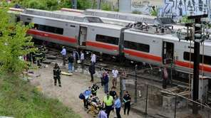 Injured passengers are removed from the scene of