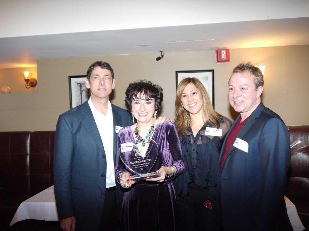 Francine Goldstein, 67, of Merrick, receives an award