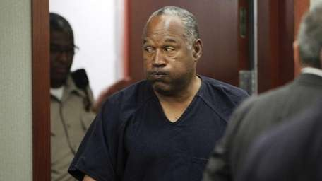 O.J. Simpson returns to the courtroom after a
