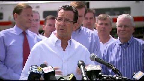 Connecticut Gov. Dannel P. Malloy and officials from
