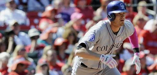 Colorado Rockies' Reid Brignac watches his three-run home