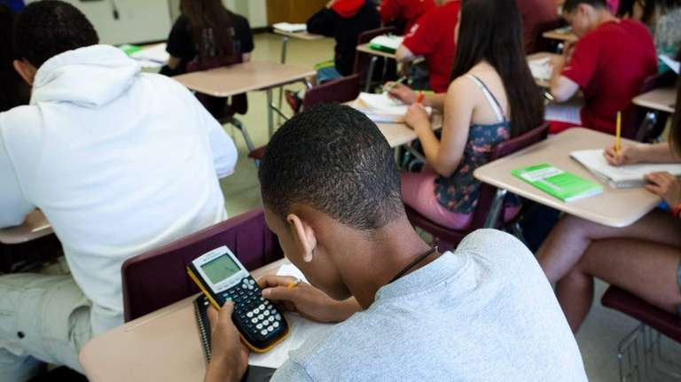 A student uses a TI-84 Plus calculator to