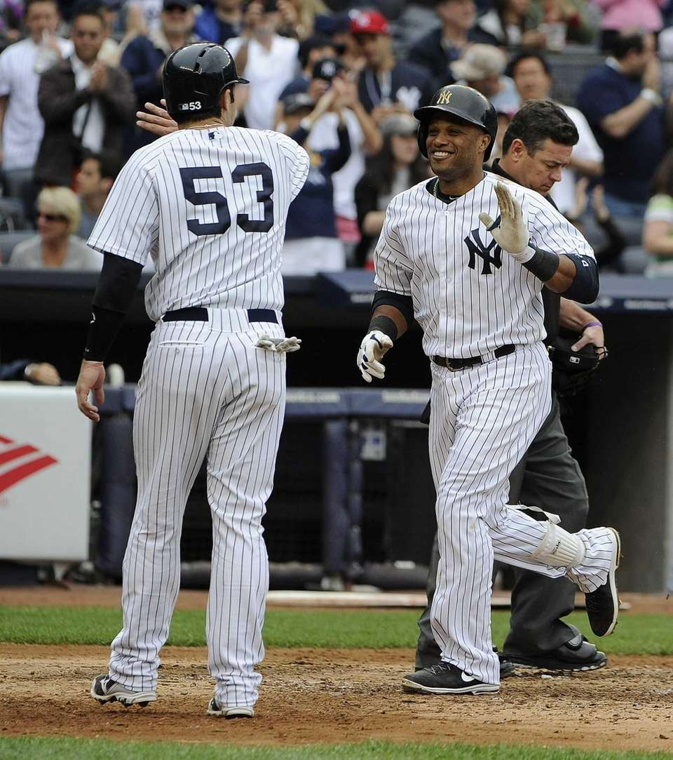 Yankees catcher Austin Romine congratulates Robinson Cano on