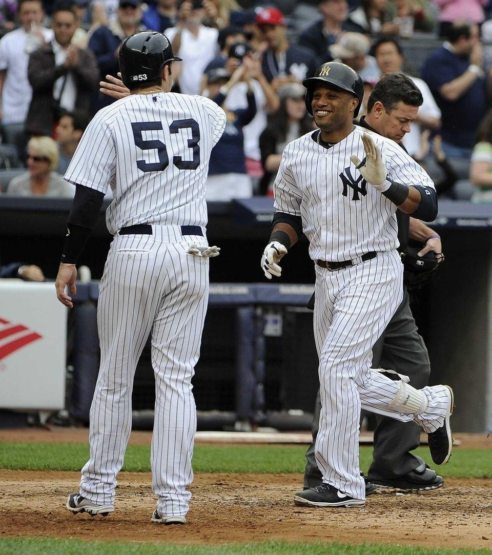 Yankees catcher Austin Romine congratulates Robinson Cano on