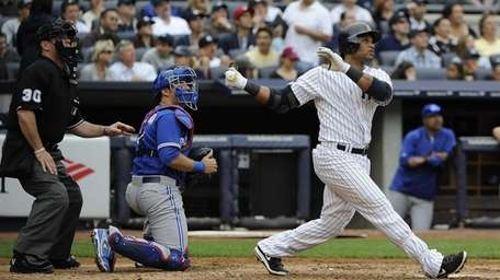 Yankees' Robinson Cano, Toronto Blue Jays catcher J.P.