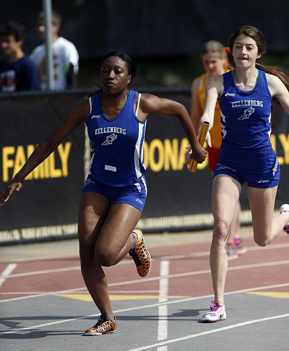 Kellenberg's Mary Camarano, right, hands off to teammate