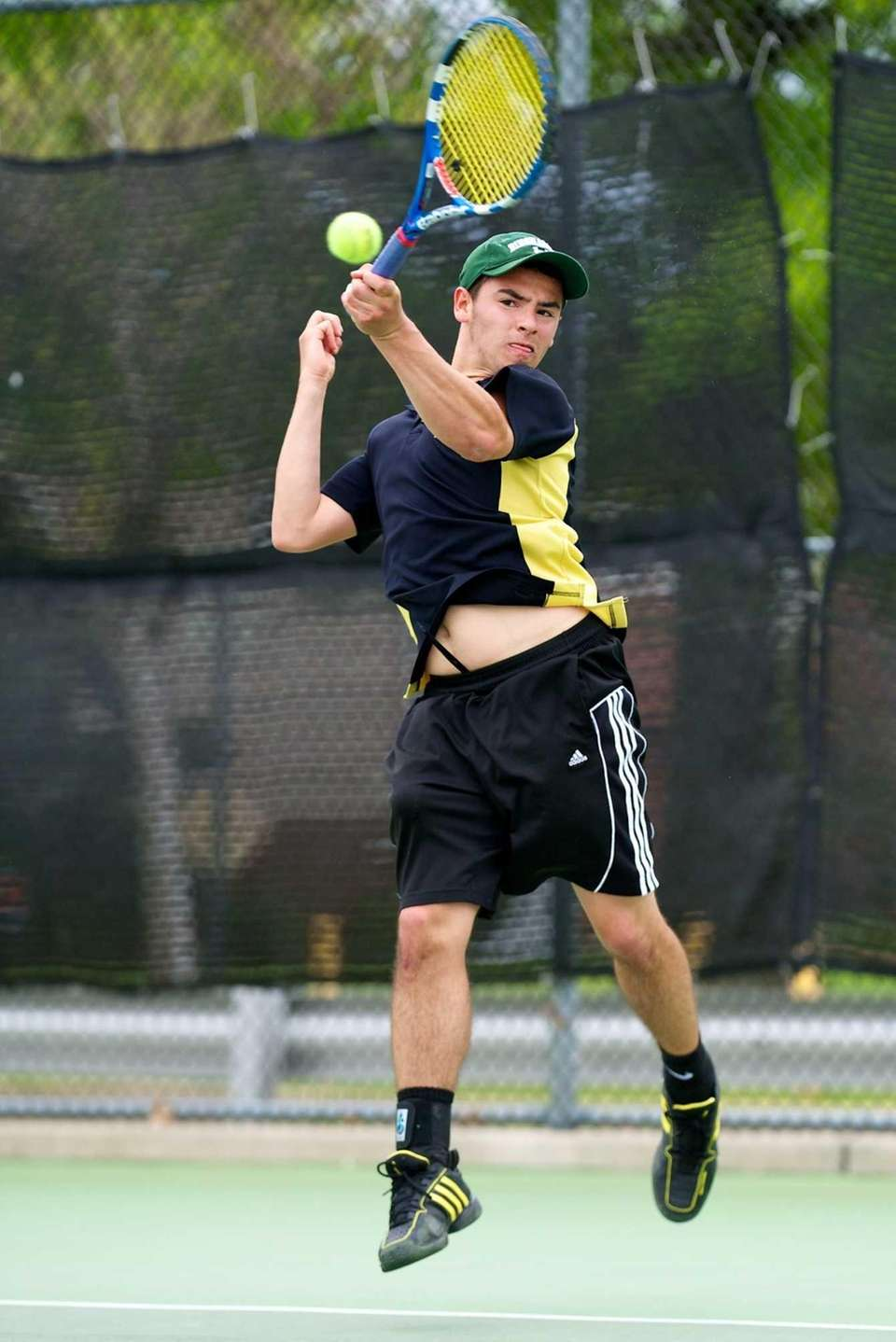 Wantagh's Doug Notaris returns a serve in the