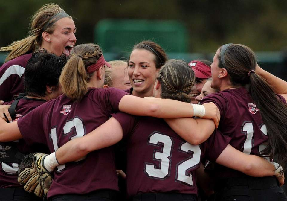 Molloy College teammates celebrate after their 8-0 win