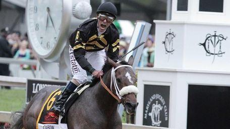 Jockey Gary Stevens celebrates aboard Oxbow after winning