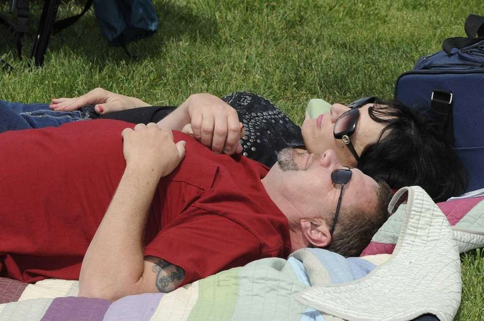 A couple takes in the sun during the
