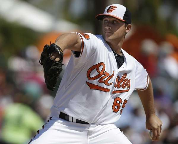 Baltimore Orioles starting pitcher Mike Belfiore throws during