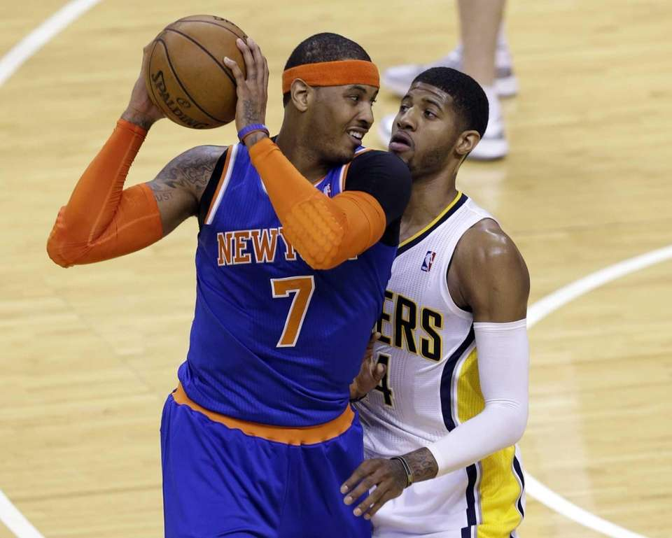 Knicks forward Carmelo Anthony looks to get past