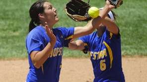 Hofstra's Becca Bigler, left, and Tori Rocha, right,