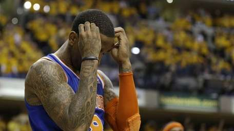 Knicks' J.R. Smith reacts late during the second