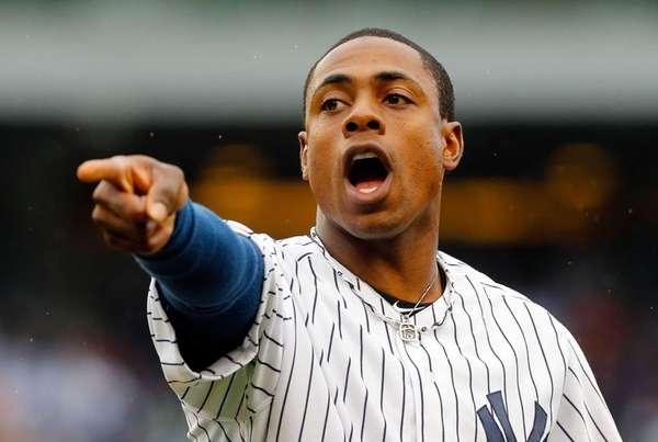 Curtis Granderson gestures to the Yankees' dugout between
