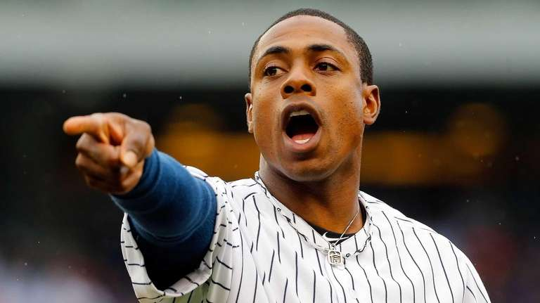 Curtis Granderson gestures to the Yankees' dugout between