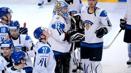 Finland's goal keeper Antti Raanta, center, and his