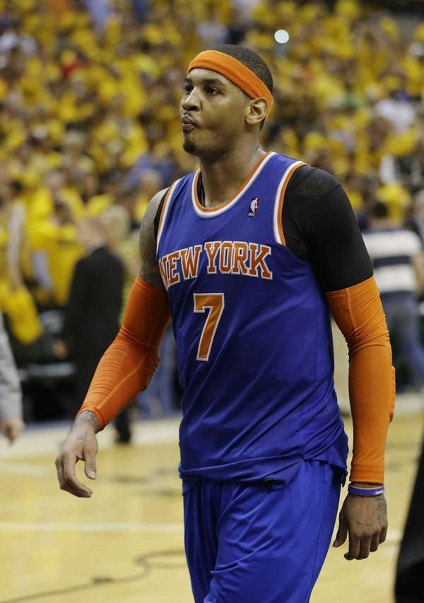 Carmelo Anthony walks off the court after the