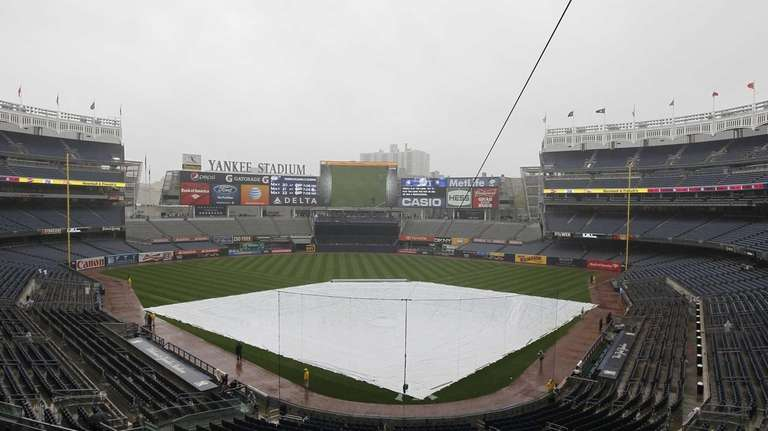 A tarp covers the field as a game