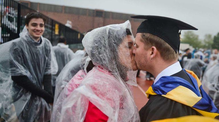 Graduating student Zach Sauerhoff, of Huntington, receives a