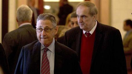 Assembly Speaker Sheldon Silver, left, walks with Assemblyman