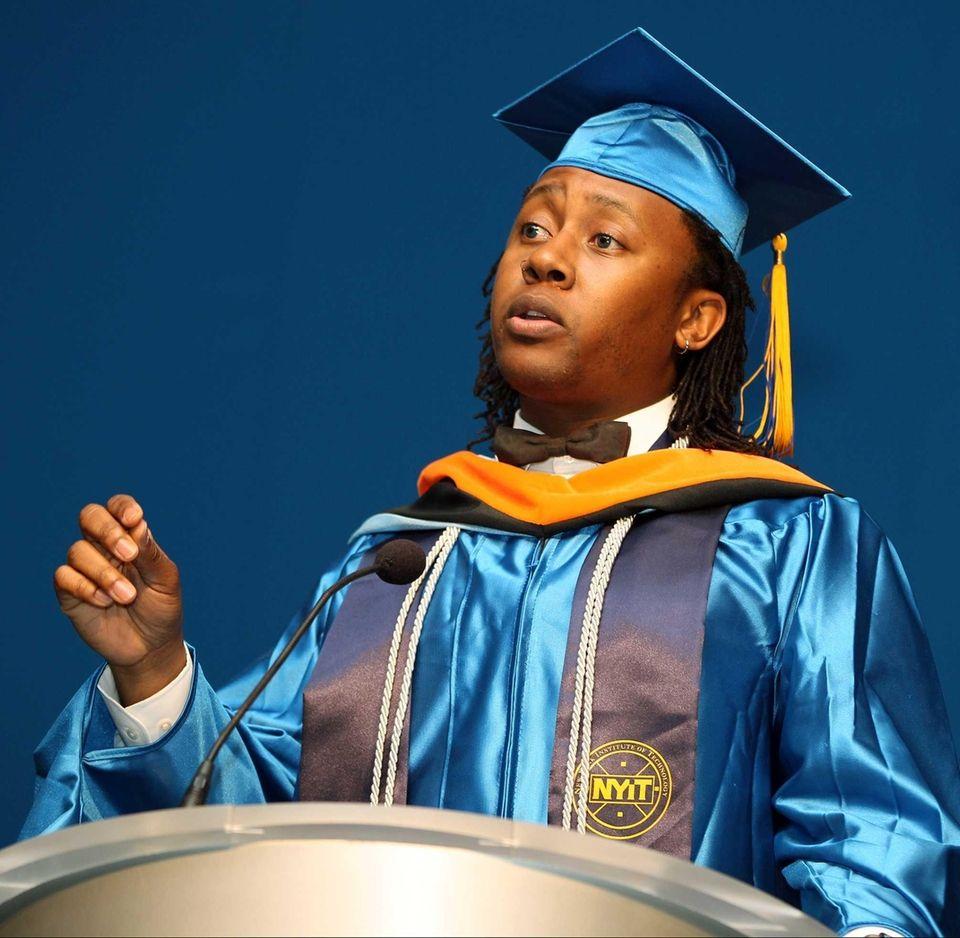Student Thulani Ngazimbi talks to fellow graduates at