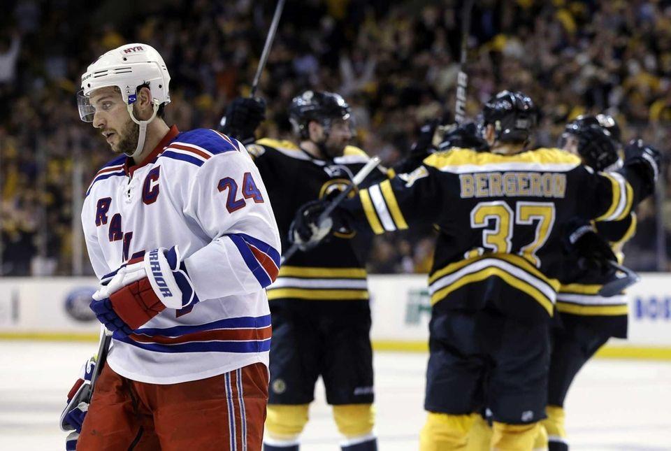 Ryan Callahan (24) skates away as the Boston