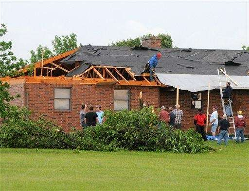 Friends and neighbors help out a resident in