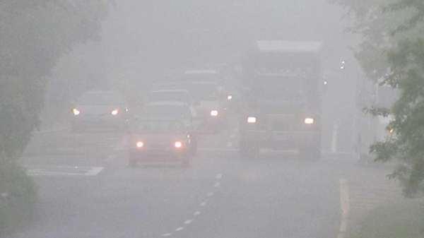 Fog blankets Pinelawn Road in Melville during the