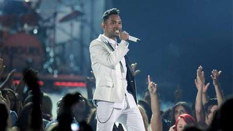 Miguel performs during the Billboard Music Awards at