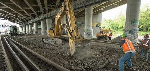 Metro-North Railroad crews work to repair tracks and