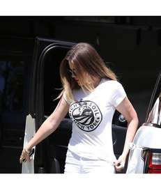 Khloe Kardashian wears a Rich Soil T-shirt that