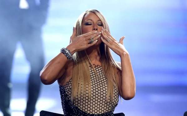 Judge Mariah Carey greets the audience at the