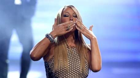 Judge Mariah Carey greets the audience at the