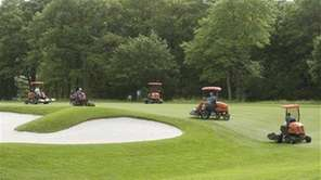 Grounds crews work at the U.S. Open Golf