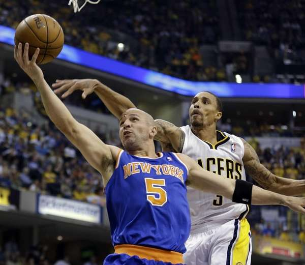 Jason Kidd shoots past the Indiana Pacers' George