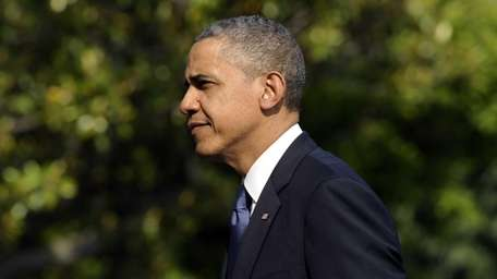 President Barack Obama walks on the South Lawn