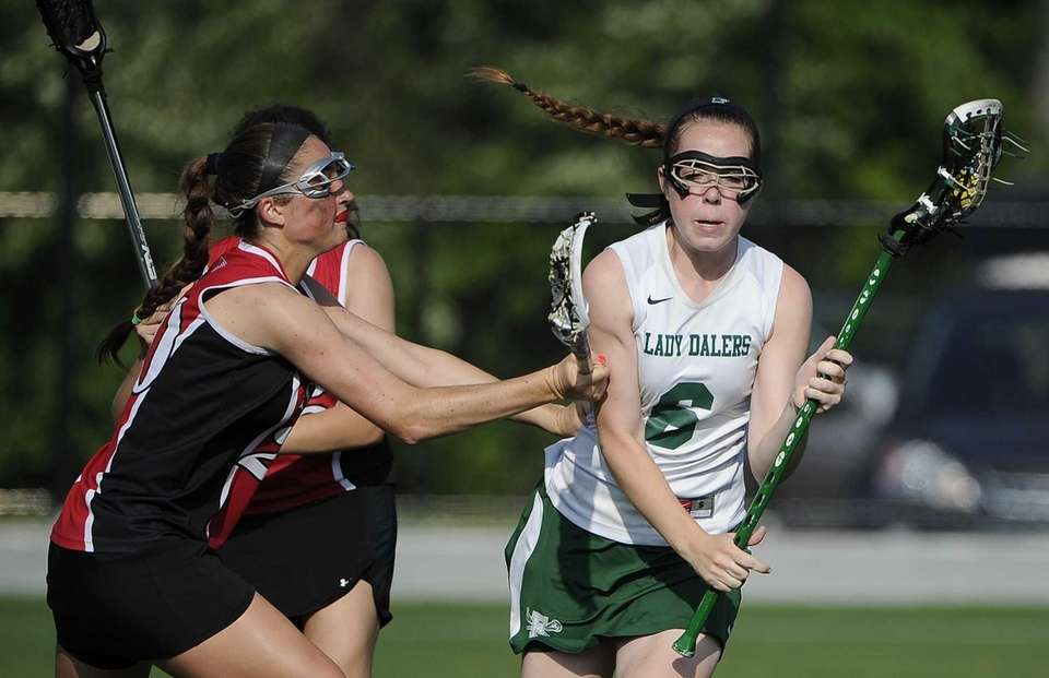 Farmingdale attacker Tara Wahl is guarded by Syosset