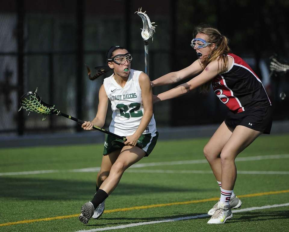 Farmingdale attacker Amanda Turturro drives past Syosset defender