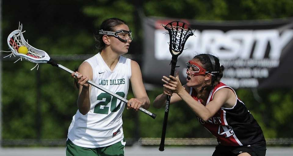 Farmingdale midfielder Nadine Hadnagy looks to pass beyond