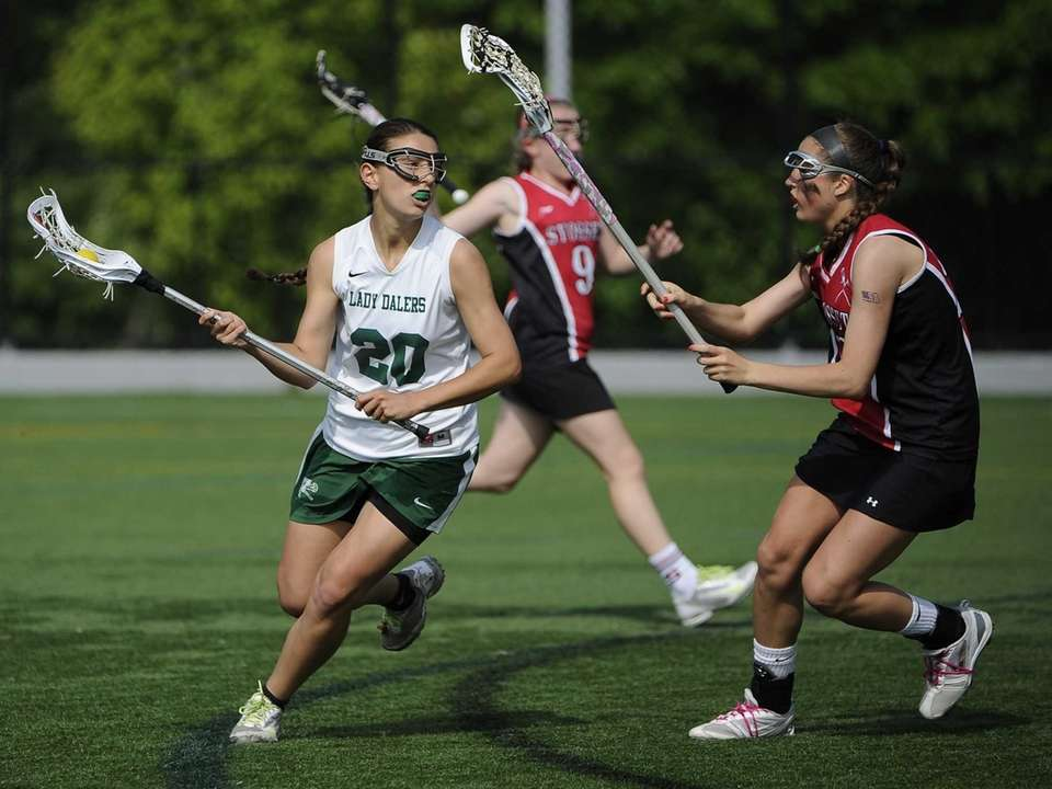 Farmingdale midfielder Nadine Hadnagy is guarded by Syosset