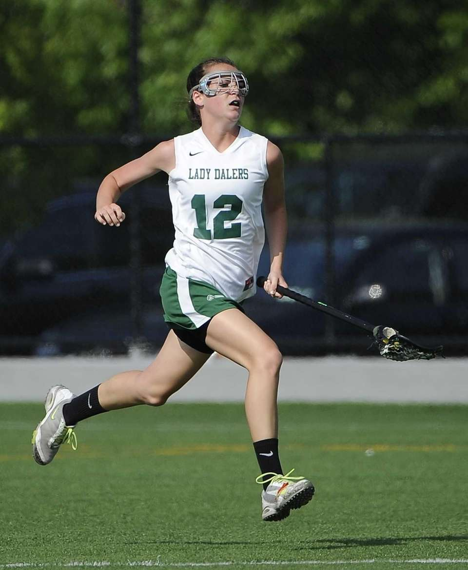 Farmingdale midfielder Laura Fullam drives the ball against