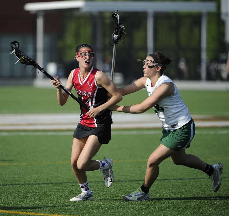 Farmingdale defender Courtney McPartland guards Syosset midfielder Rachel