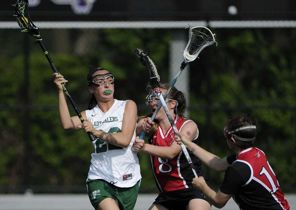 Farmingdale midfielder Nadine Hadnagy attempts to drive past