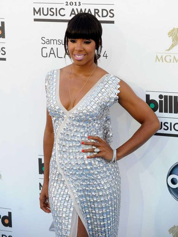 Singer Kelly Rowland arrives at the 2013 Billboard